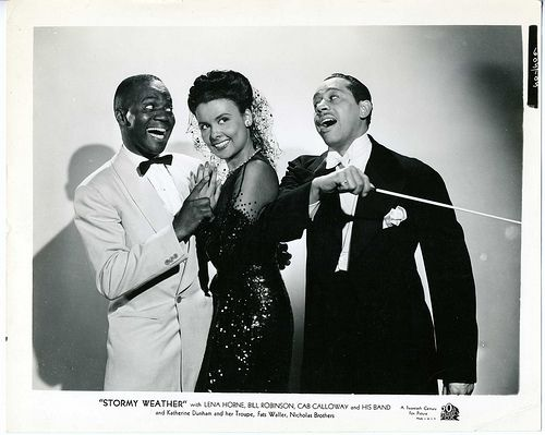 The iconic film Stormy Weather (1943), [loosely based on Robinson's own life],  follows a soldier coming home from war who wants to start a life as a performer. This 20th Century Fox production was one of the first nationally successful Hollywood films that featured an African-American cast. Stormy Weather was selected for preservation in the National Film Registry [Image: Bill Robinson, Lena Horne and Cab Calloway, 1943]
