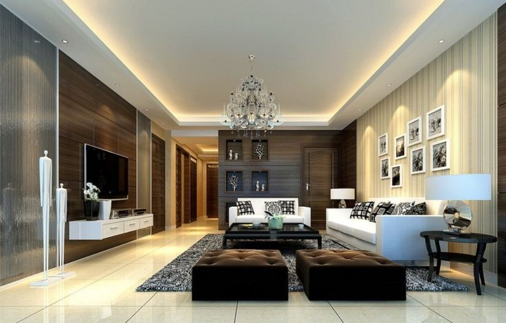 [Living Room] : Luxurious Living Room Design With Neutral Shades With White Couch With Cushion Also Brown Pouffe Along With Attractive Coffee Table And White Flooring Tiles With Grey Synthetic Rug Also Luxury Crystal Chandelier Also Flat Screen Tv
