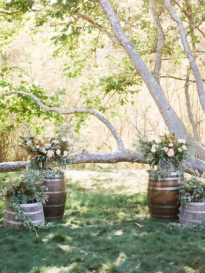 Modern Ranch Wedding Ceremony with Wine Barrels and Greenery
