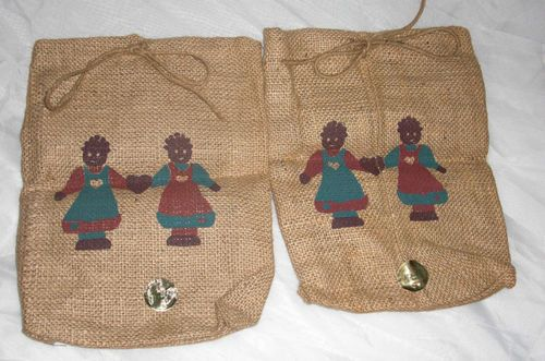 2 black american girls holding hands burlap sack Halloween treat candy bag