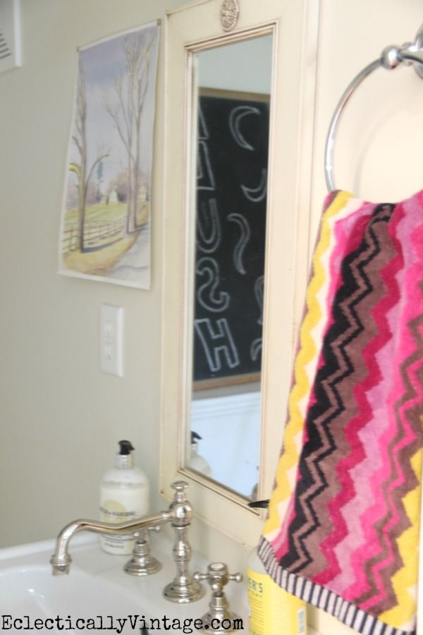 Small powder room carved in a nook under the stairs eclecticallyvintage.com