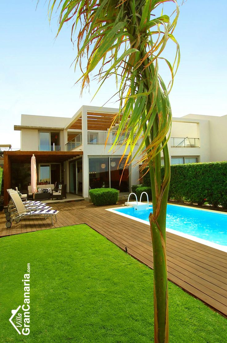 Villa with pool and terrace Gran Canaria Vacation rentals, Holiday Home, Ferienhaus. Tropical palm tree with blue pool.