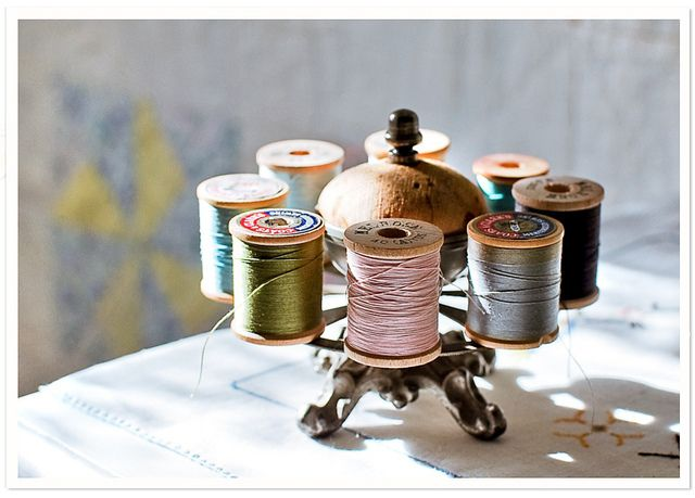 Vintage thread holder...where the heck can I get one of these??  Too cute!!  I found this pic on flickr... cindy {k} took it.  =)
