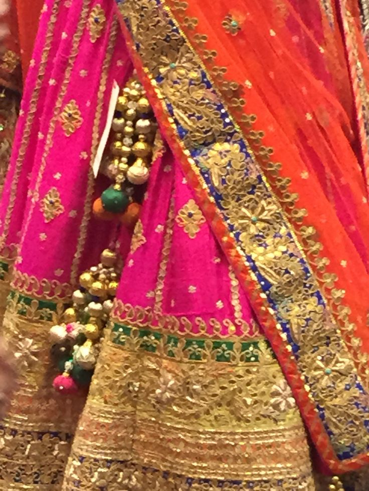 Juust Pink beautiful arisen fashion. Close up of embroidery detail.