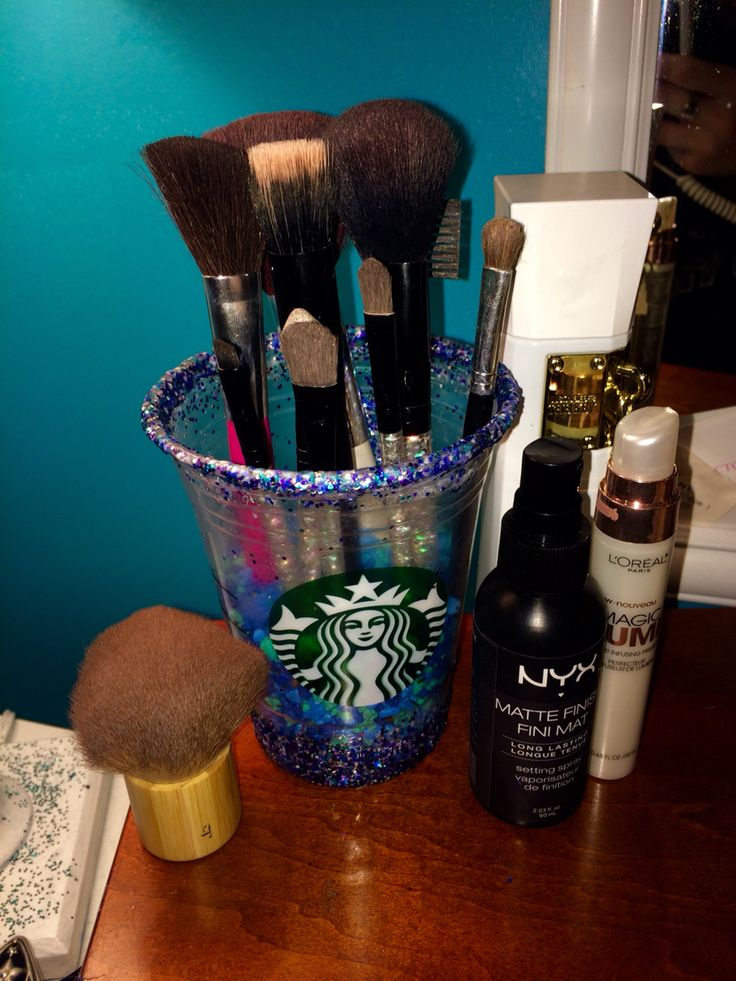Super easy DIY for the typical white girls! You will need modge podge, glitter and fish tank rocks. Coat your cup in modge podge where you would want the sparkles. Next sprinkle the glitter. Next coat it in modge podge again. It will act like a gloss. After put fish rocks in your cup. And BOOM makeup brush holder.