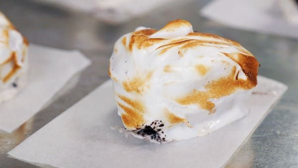 Recipe with video instructions: If Dominique Ansel can make frozen s'mores, so can we with ice cream covered in wafers and topped with seared marshmallows. Ingredients: 2 1/2 pints vanilla ice cream , 1 sleeve chocolate wafers, finely crushed, Marshmallow cream/fluff, Wooden chopsticks