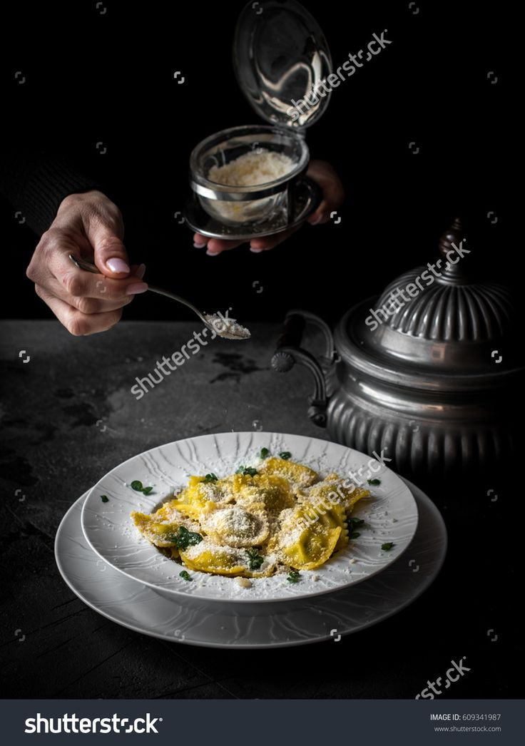 Italian ravioli in the white plate on the dark backgrond