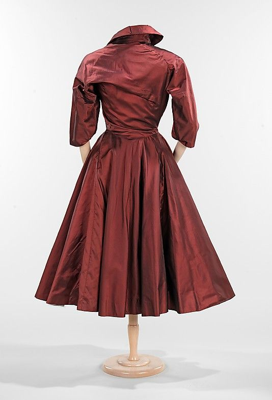 Burgundy silk dress, 1950, Charles James (back view) Many of his pieces are conceived asymmetrically and possess a sense of movement and vitality that is a signature characteristic of his work.