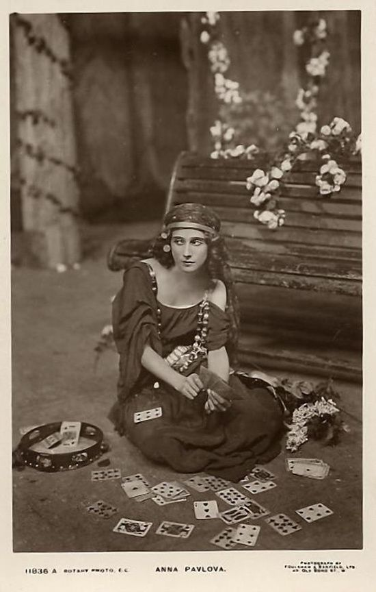 Anna Pavlova as a gypsy telling fortunes with cards.