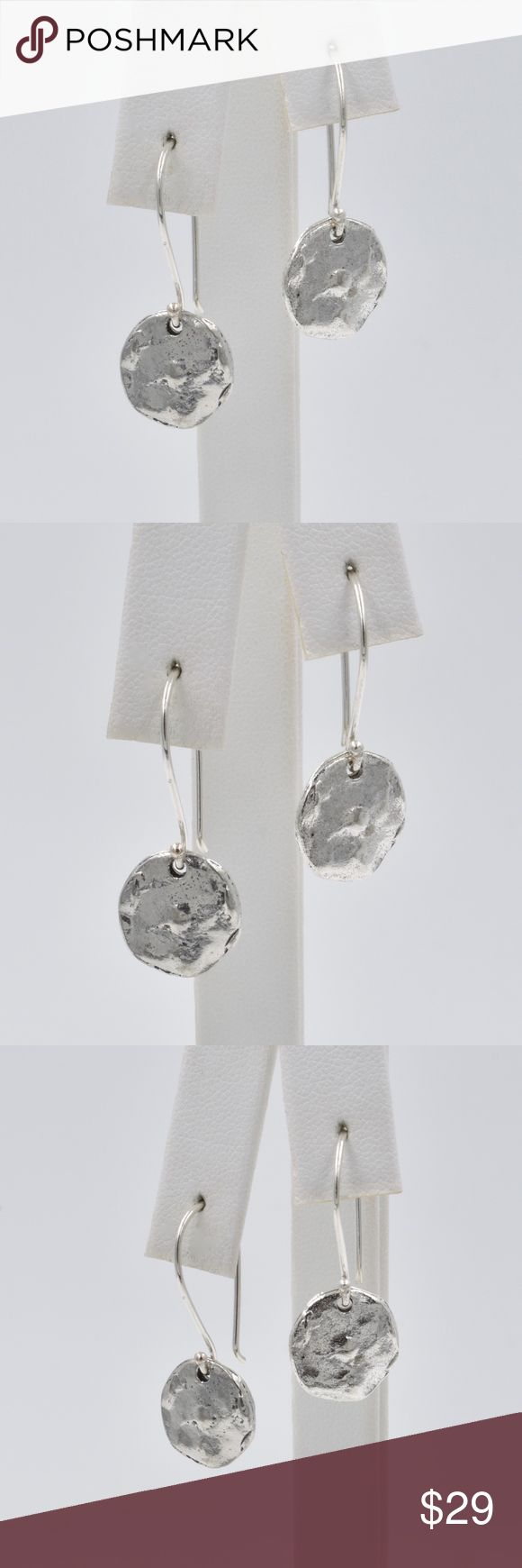 "Silver Disc Dangle Earrings on Shepherds Hook Very cool hipster look earrings.  These dangles will go with any look and will become your everyday earring.  The shepherds hooks are sterling silver and the hammered discs are silver tone metal.  The disc is about 7/16"" and the earring dangles about 1 1/4"". Jewelry Earrings"