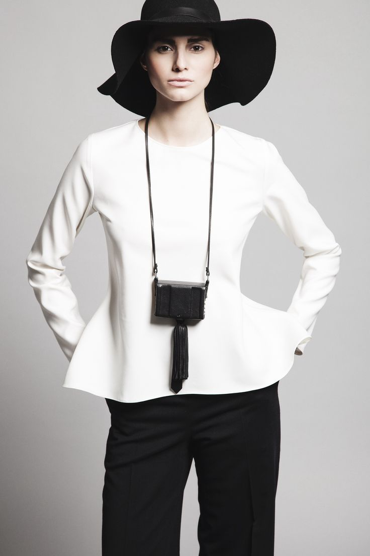 Ivory fleece wool and silk blouse MELISSA, black cool wool side pleating trousers THESEUS and black leather small bag ATTIKI