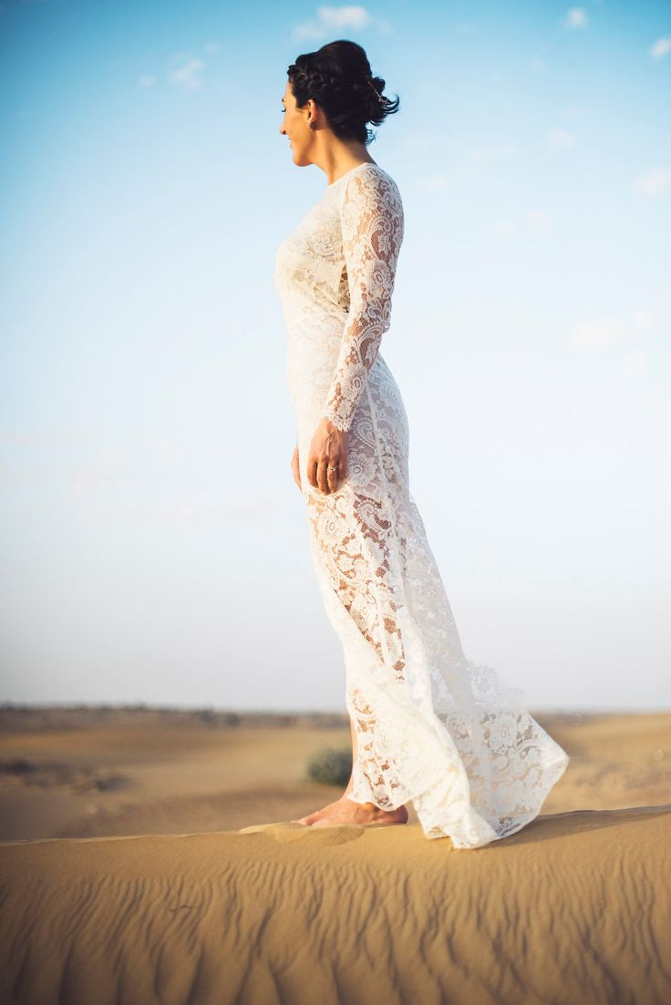Our bride, barefoot in the desert in her custom made Daalrna lace wedding gown