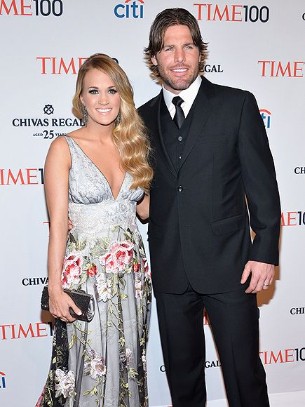 Carrie Underwood gets a show of support from husband Mike Fisher on Tuesday night at the star-studded TIME 100 Gala in New York City