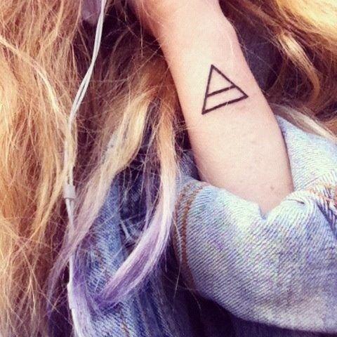 simple geometric tattoo.