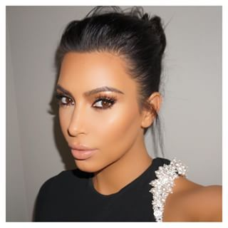 You're probably used to seeing Kim Kardashian like this. Contoured, lash-ed out, and 100% glam. | Kim Kardashian Went Makeup Free On The Cover Of Vogue Spain