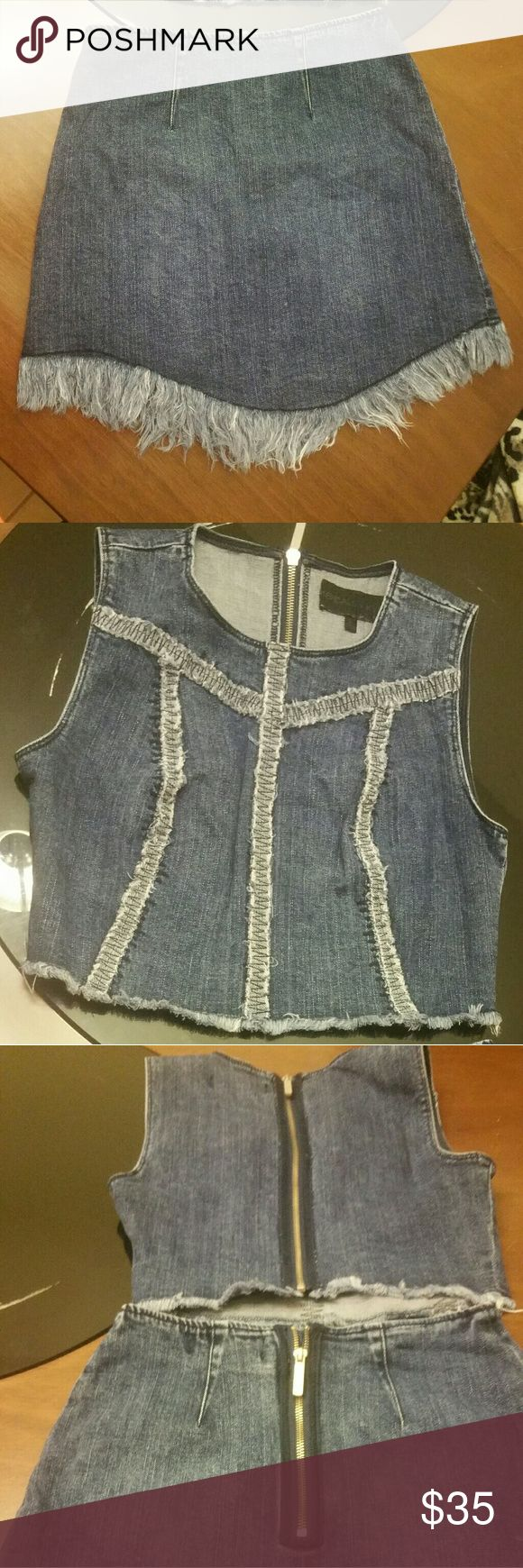 Kendall +Kylie outfit blue jean skirt &top Kendall + Kylie blue jean skirt set size small fits really cute frayed at the bottom of the shirt & the bottom of the skirt zips up the back of the skirt in the back of the top no holes and no stains like new from a smoke free home no pets Kendall & Kylie Other