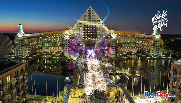 """""""Disfruta una mágica estancia en el hotel Walt Disney World Dolphin, ubicado dentro del fantástico Walt Disney World Resort en Orlando. Habitaciones espectaculares te esperan, a la par de elegantes instalaciones, como spa y cinco piscinas que le darán un toque de lujo a tus próximas vacaciones en Orlando Florida. El hotel ofrece dos funcionales centros de negocios y salones de gran capacidad para la realización de eventos, por lo que es también una excelente alternativa para congresos y…"""