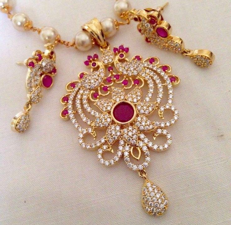 CZ and ruby stone pendant with pearl drops and earrings Code : PS 372 Price: Rps. 1195/- Whatsap to 09581193795 for order processing