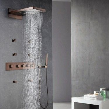 Thermostatic wall-mount waterfall rain shower hand shower system with body spray in ORB for your luxury bathroom.