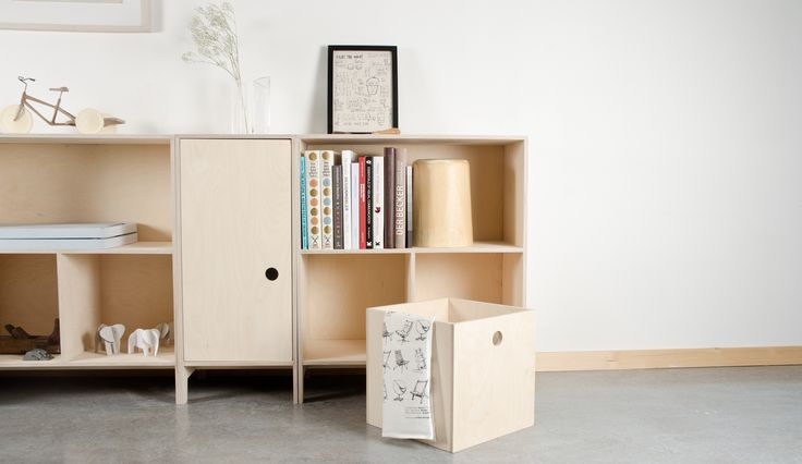 Villmann modular shelving units in birch plywood.