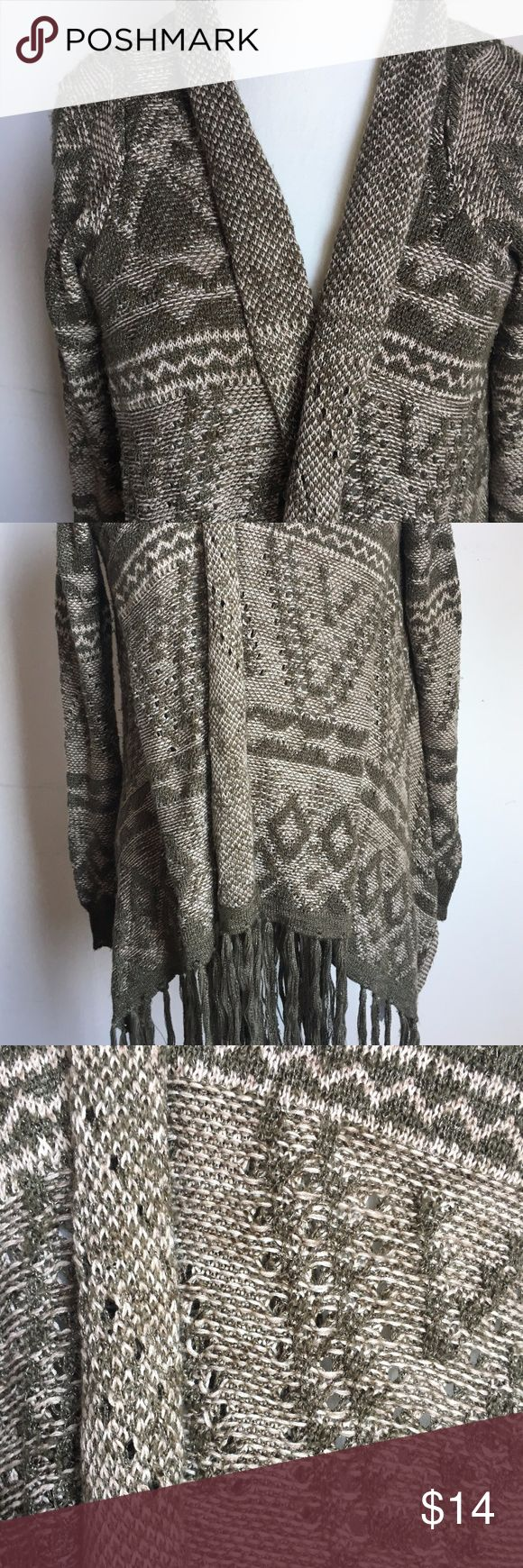 LIKE NEW Tribal Sweater Cardigan with Fringe Perfect for fall and winter! Unique cardigan sweater (short duster) with slant fringe (not overzealous) hem and slightly higher straight back hem EUC! size. Medium color. Olive Green, Cream, with barely noticeable shiny pearl like thread woven through (not glittery, bling looking at all) print. Tribal, Southwest, Aztec, Western Sweaters Cardigans