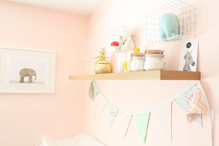 Changing station with animal prints and modern bunting