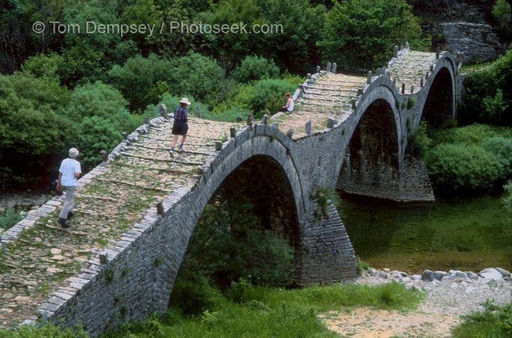 Kalogeriko triple-arch stone bridge near Kipi, Zagoria, Greece. Photographer: Tom Dempsey
