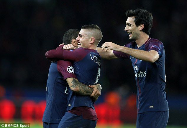 Marco Verratti is embraced by Dani Alves and Javier Pastore after his record-breaking strike