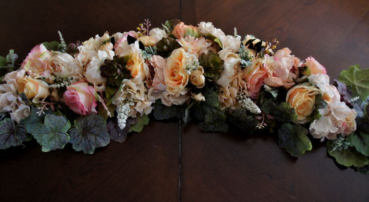 Beautiful wedding arch swag. These flowers are the perfect accent to your shabby chic, vintage or outdoor wedding. It is made with beautiful peonies, champagne hydrangeas, decorated vine leaves. It is approx 72 inches in length, central flower part is about 40 inches . These are perfect for destination wedding as they are relatively light.  I can customize it any way you need.  Matching bouquet is here…