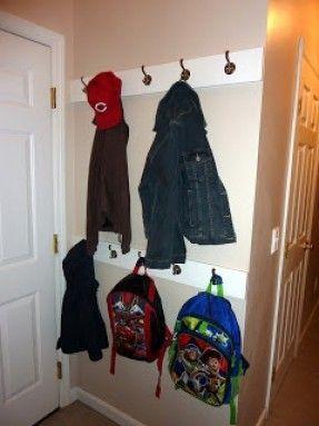 Make multi layer coat rack behind the front door