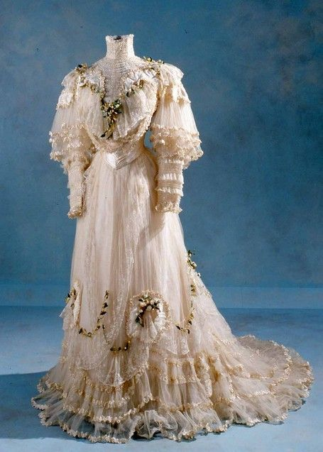 Circa 1900s Wedding Dress Made Of Satin Covered Lace With A Lily-Of-The-Valley Motif, made by Leroux & Co., and designed by Felix.