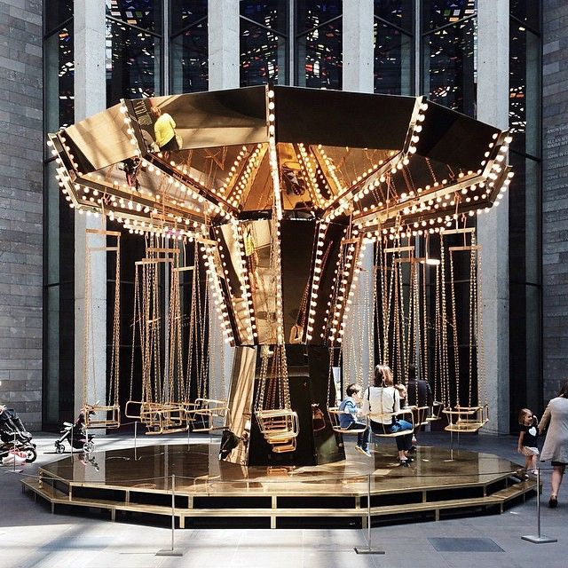 """Golden mirror carousel by Carsten Höller. Image by @agiasidi"""