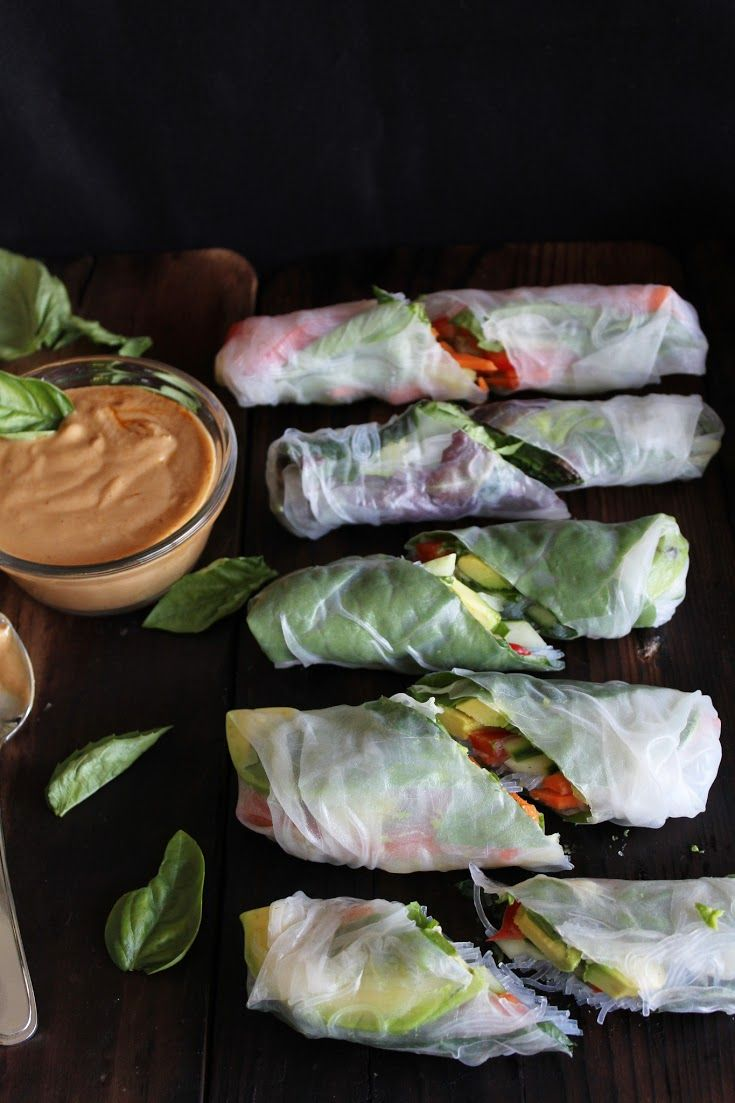 Fresh summer rolls with basil, avocado, kale, + spicy garlic peanut sauce