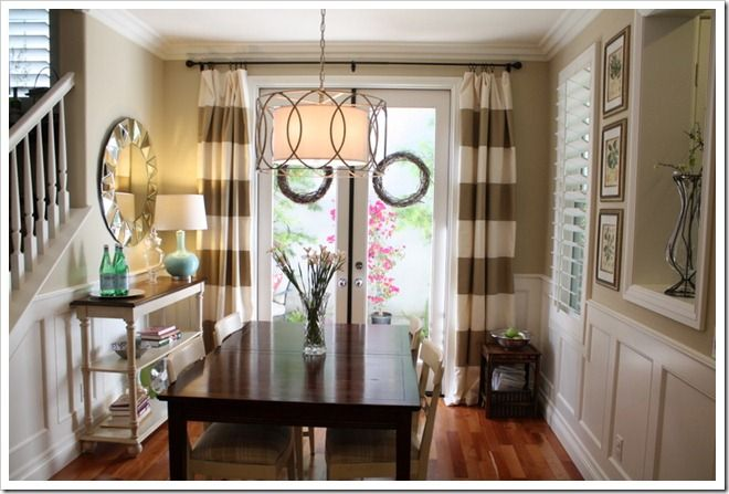 love... mirror, chandelier, striped curtains, & little peep-hole (such character!)