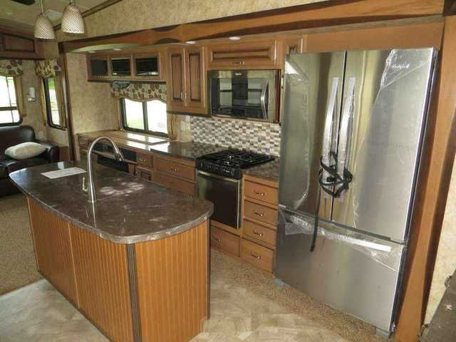 2016 New Forest River Cedar Creek 36CKTS Fifth Wheel in South Carolina SC.Recreational Vehicle, rv, 2016 Cedar Creek 36CKTS 2016 Cedar Creek 36 CKTS Cedar Creek 36 CKTS All Aluminum Framing 16 O/C Gelcoat Fiberglass Exterior Front Gelcoat Cap Pearl Edition Exterior Package Black Awning W/ Metal Cover 46 Inch LED TV Digital DVD & Surround Sound-Living Room Bedroom TV 12 Gal. W. Heater 15,000 BTU Ducted A/C 2nd Ducted Roof A/C Auto 6 Point Hydraulic Leveling Selector Switch For Slide Outs 3…