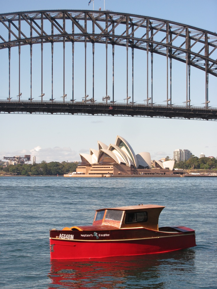 Neptune's Daughter on Sydney Harbour with the Sydney harbour Bridge and Sydney Opera House in ...