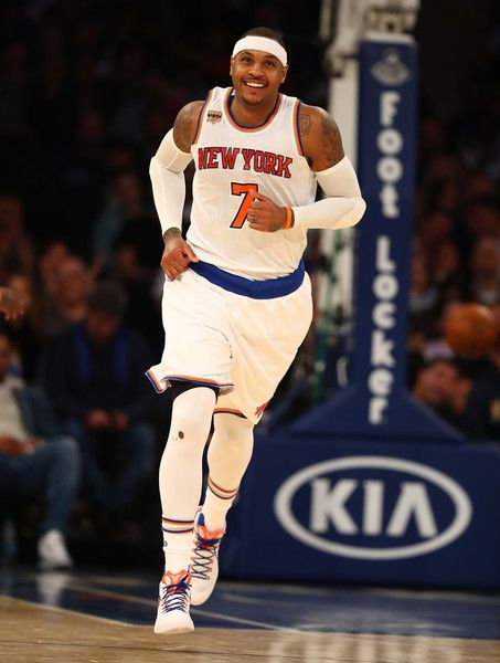 Carmelo Anthony #7 of the New York Knicks smiles after scoring a basket against the Detroit Pistons during their game at Madison Square Garden on November 16, 2016 in New York City.  NOTE TO USER: User expressly acknowledges and agrees that, by downloading and/or using this Photograph, user is consenting to the terms and conditions of the Getty Images License Agreement.
