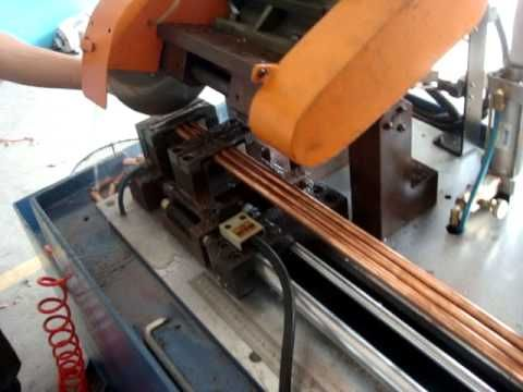 circular sawing machine cutting copper pipe - YouTube