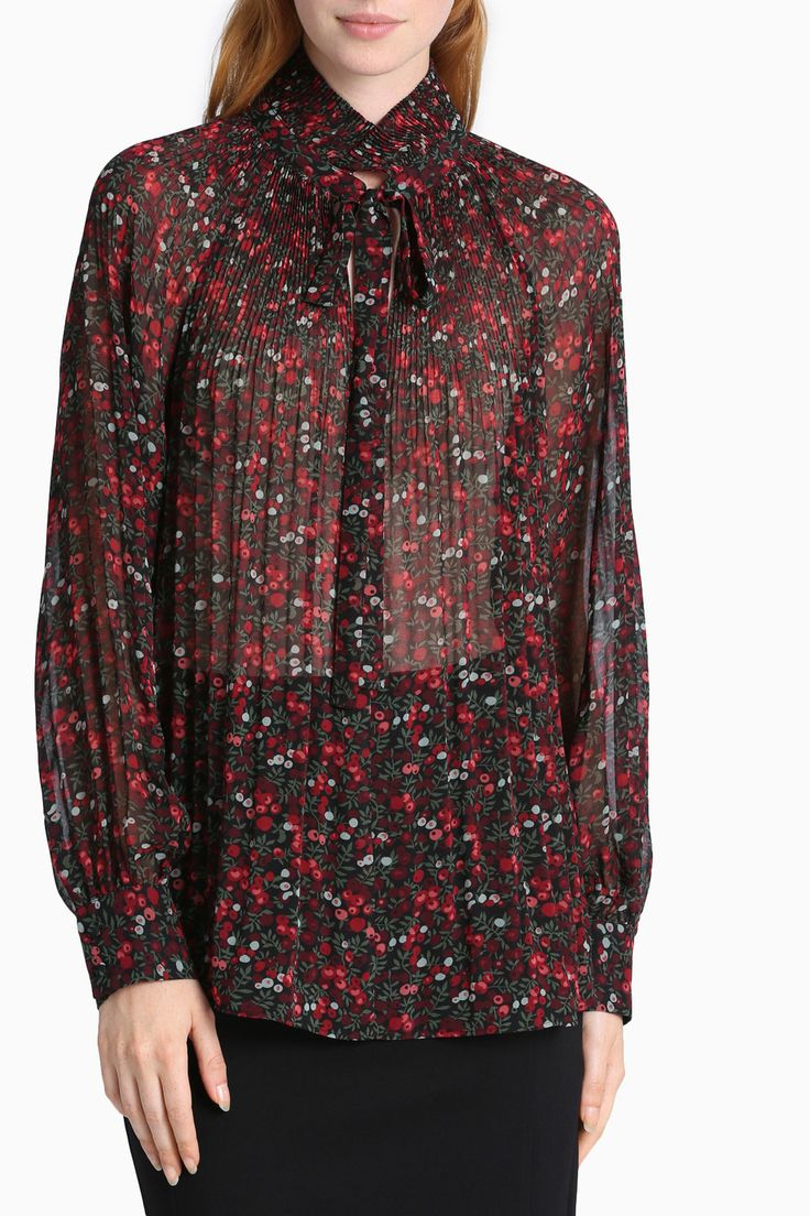 Ditsy Rose Print Sunray Pleat Blouse $139.95 June 2016 LEONA BY LEONA EDMISTON. 100% polyester. Cold hand wash separately, reduced spin, dry in shade, do not tumble dry, do not iron pleats, cool iron if required, dry cleanable. Style No. XL0665.