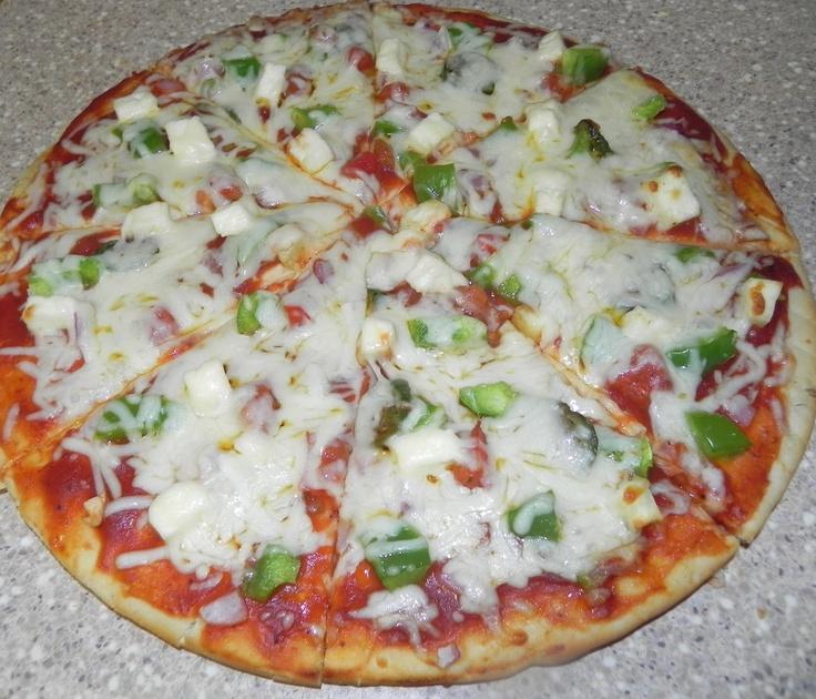 Take Yummiiiiii  Test of Pizza.........  http://www.easyindianfoodrecipes.info/paratha/pizza-parotha-recipe.html