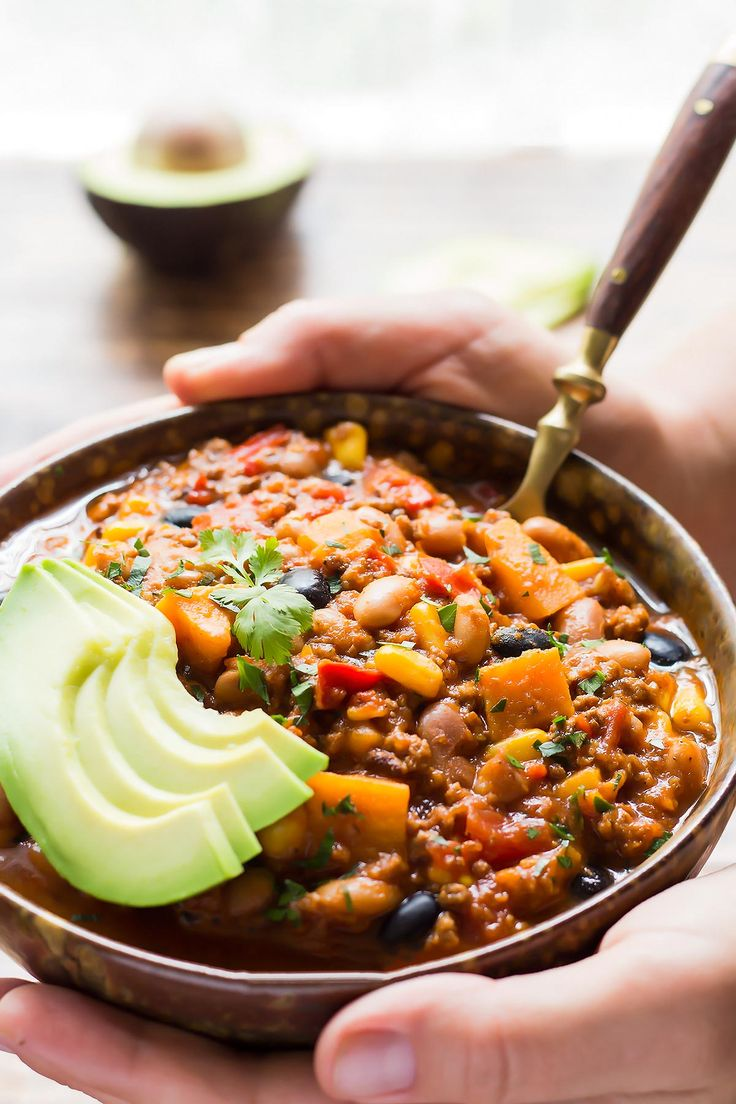 This amazing Instant Pot Chili is guaranteed to satisfy any comfort food cravings! The optional twist for Southwest Chili includes sweet potatoes and corn for a delicious sweet & spicy flavor kick. ~~~~ Electric Pressure Cooker | Stew | Recipe | Soaked Beans | Ground Beef | Fall | Winter | Hearty | Black Beans | Healthy