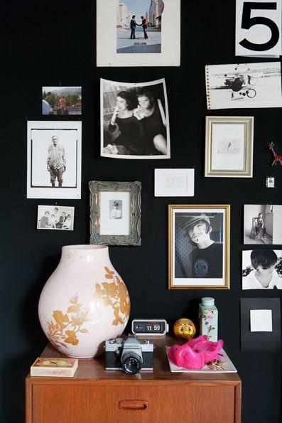 black + white photos on a dark wall