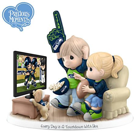 Precious Moments Seattle Seahawks Fan Porcelain Figurine - I love how it has a little doggy in it!