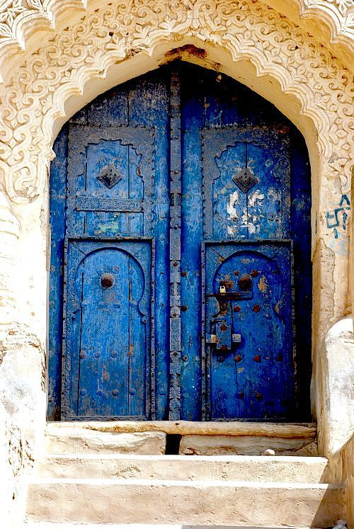 Yemen doors. I love the design of the creamy colored archway in contrast with the weathered blue door.