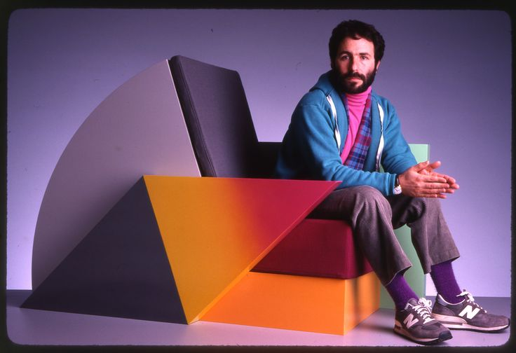 """Peter Shire seated in his """"Bone Air"""" chair, 1985. See more on: https://nl.pinterest.com/aart4art/peter-shire-designer/"""