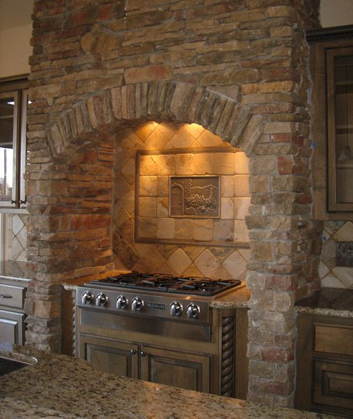 Stone kitchen cooktop surround. Hadn't thought about lighting before...