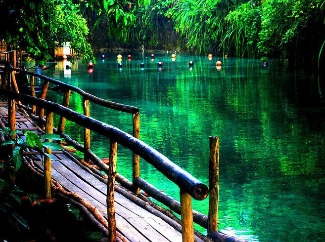 The Enchanted River (real name: Hinatuan River) runs through the island of Mindanao in the Philippines,