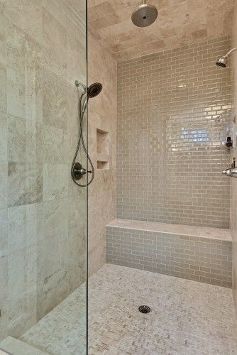 Seat idea. Like reflective grey/white subway tile on back wall with grey travertine tile on other shower wall. Do the grey travertine on floor too. Great niches - one perfect for soaps.