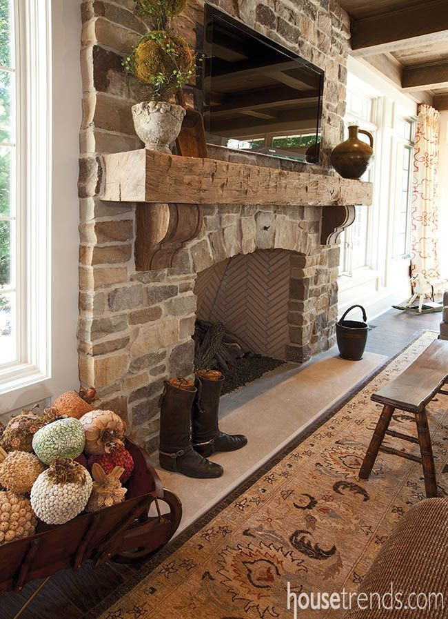 A stone fireplace with a rough-hewn mantle light up this room with some charm. #housetrends