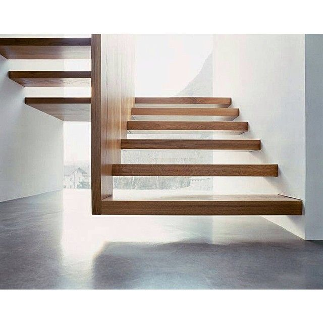 Floating wooden staircase.